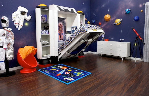 Space themed bedroom with half open fold out bed and 3D planet decorations stuck to the wall