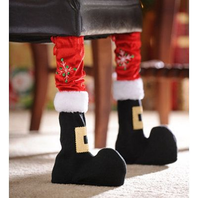 Dining chair legs decorated to look like Santas feet and legs
