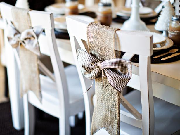 Wooden dining chairs with hessian decorations and brown and white checked bow