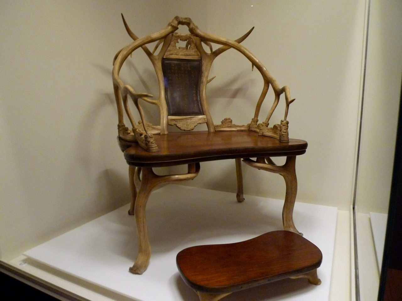 Deer antler arm chair with matching foot stool