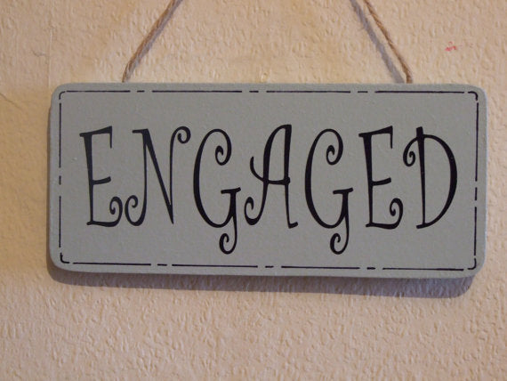 Reversible door sign that says engaged