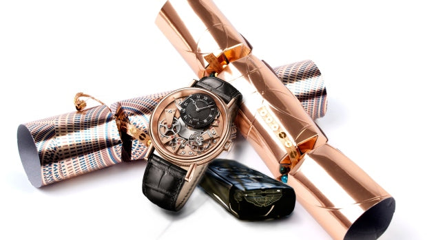 Luxury Christmas crackers with expensive gifts such as a watch