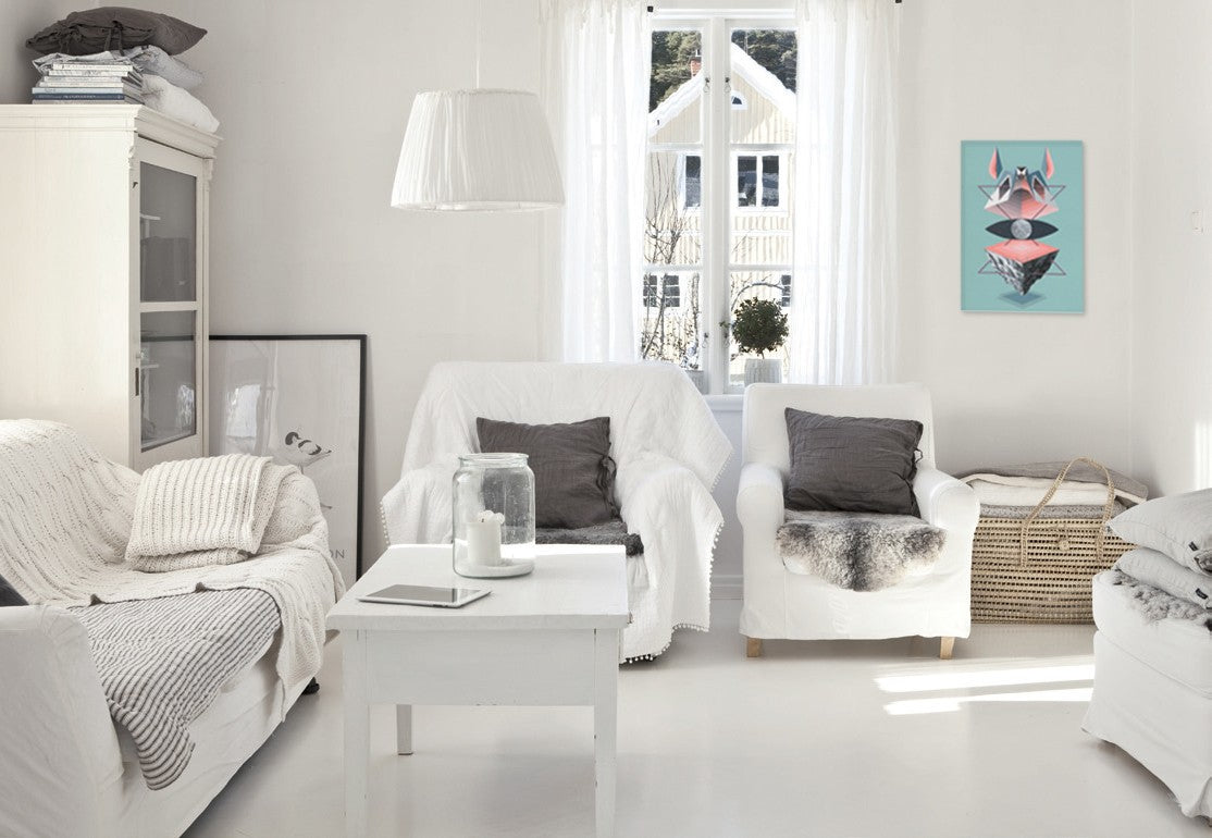 White living room with white throws on white chairs and white accessories