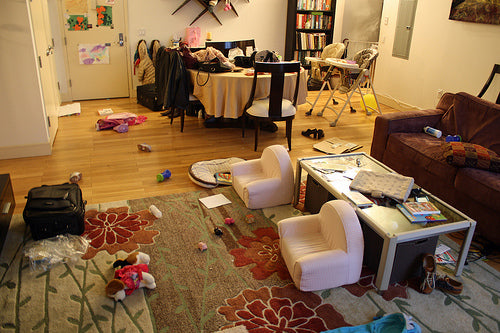 Messy house, with kids toys all over the floor