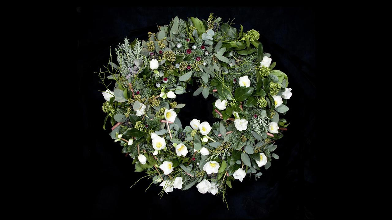 Christmas wreath with berries and white flowers