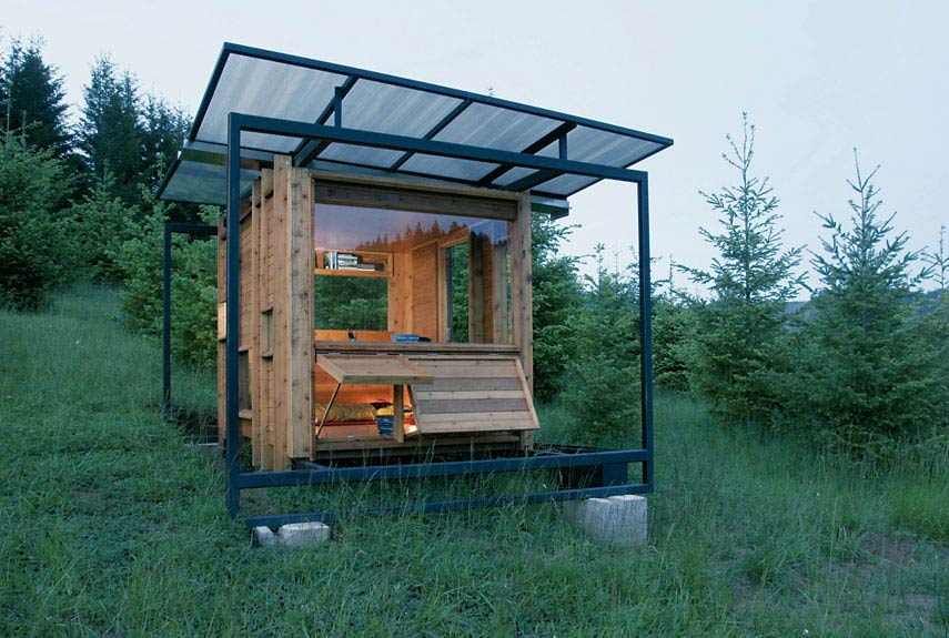 Compact wooden box that is used as an outdoor bedroom with fold out tables