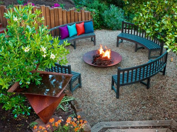 Four curved benches facing each other in a circle with fire pit in the middle