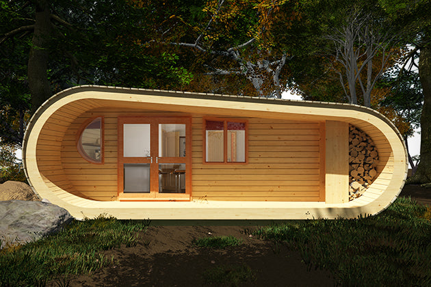 Eco tiny house pod made from wood and sitting under some trees