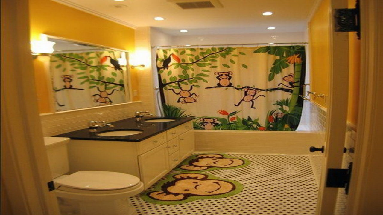 Monkey themed bathroom with shower curtains and two bathroom rugs