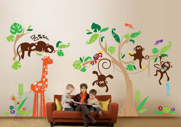 Monkey, giraffe, parrot and trees room decal behind a reading couch