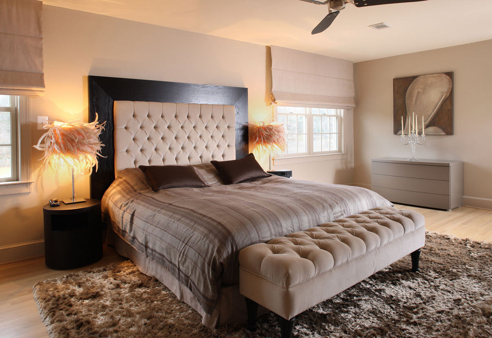 Beige Bedroom With Striped Bedding, Dark Brown Cushions And Two Fluffy Bedside Lamps