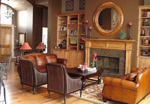 Brown Leather Sofas, Wooden Fireplace, Mirror And Cabinets