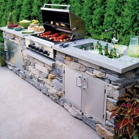 Large stone barbeque pit in a garden