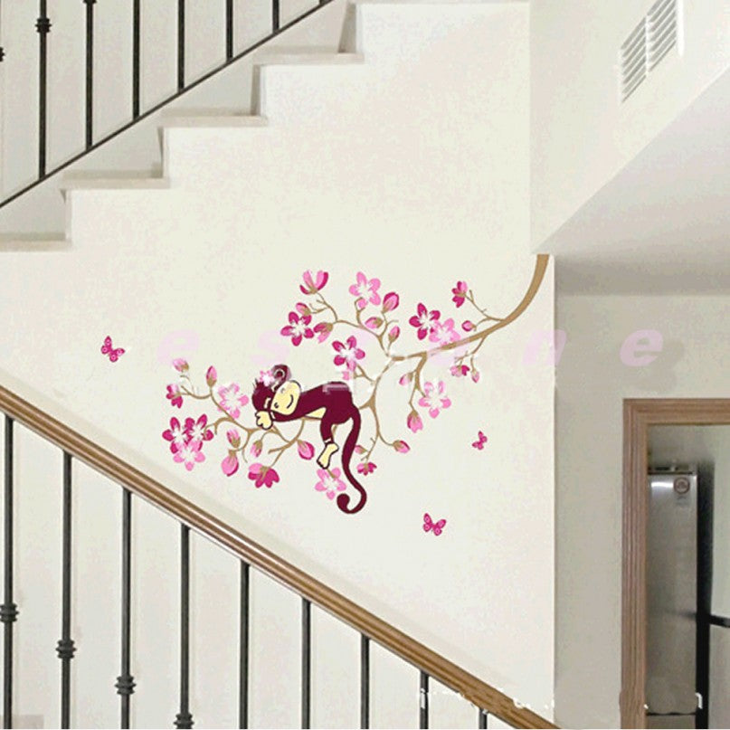 Pretty pink tree and monkey decal on a staircase