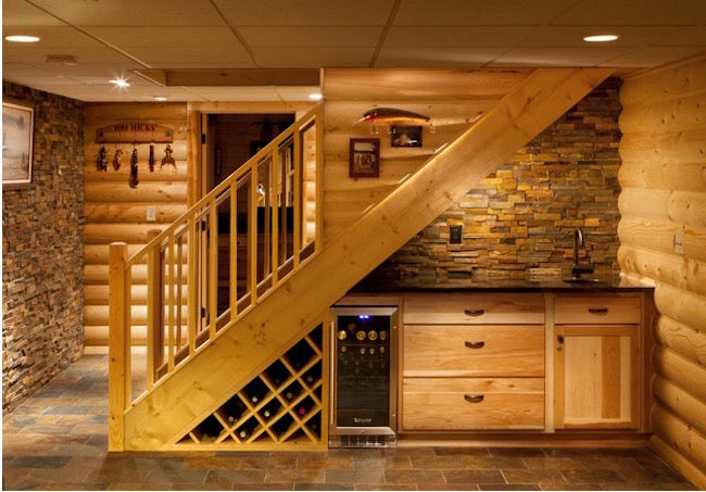 Wooden staircase with wine storage underneath