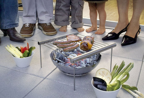 Mini barbecue rack above a metal bowl of burning charcoal