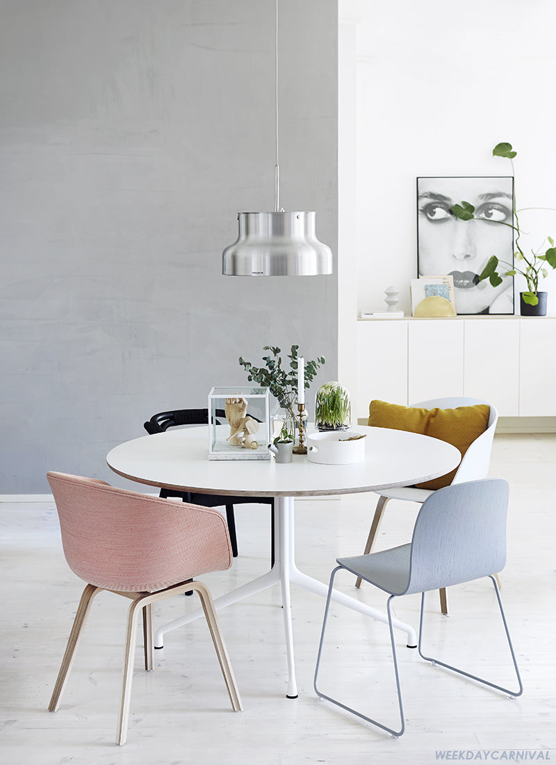 Serene And Modern White Round Dining Tables With Soft Pastel Shades As Accent Colours