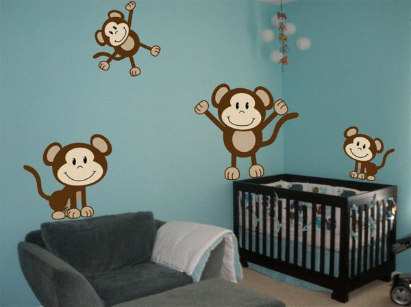 Playing monkey wall decals in a blue nursery