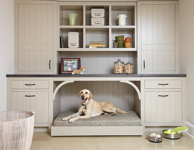 Taupe mudroom cabinets with built in dog bed and cupboard and drawer storage