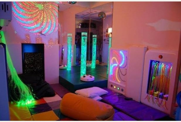funky sensory room with lava lamps and strobe lighting