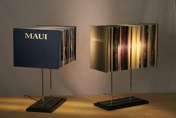 Two lamps, with lampshades that look like a collection of books