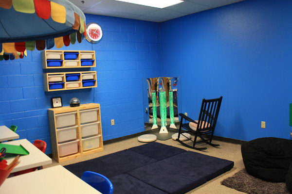 Dark blue sensory room in a scout building