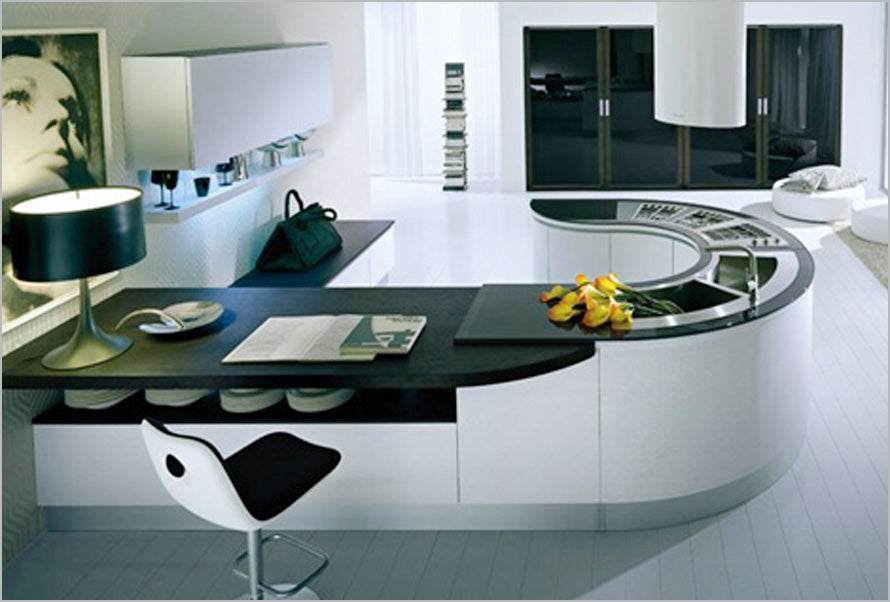 A hook shaped kitchen counter with sink and storage space, plus breakfast bar