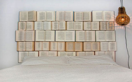 A bed headboard made from opened books