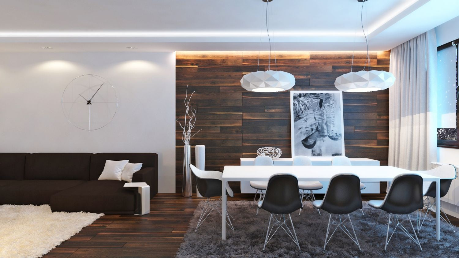 Wooden feature wall, matching the dark wooden flooring, with white table, accessories and a brown sofa
