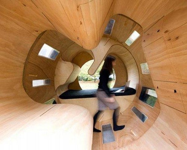 Wooden pod with seats and central area for exercising like a hamster