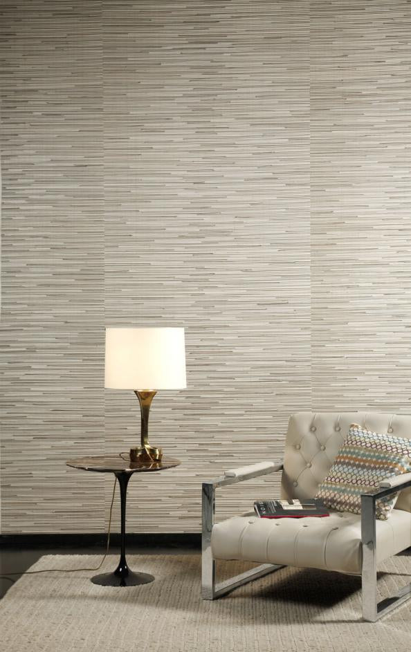 Modern seagrass cream wall, with cream arm chair and table lamp