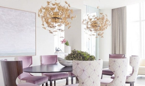 White and lilac dining too with pretty butterfly-esque gold lamp shades