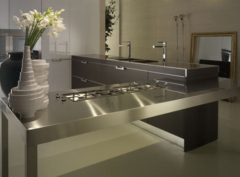 Modern silver and dark grey kitchen with cream tiled walls and floors