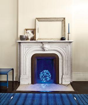 White metal traditional fireplace with blue orb light in the hearth