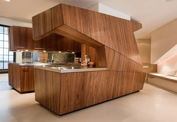 Kitchen area made from wooden panels that is enclosed like a kitchen pod in the middle of the room