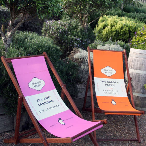 Beach chairs in pink and orange with fabric section designed to look like book covers