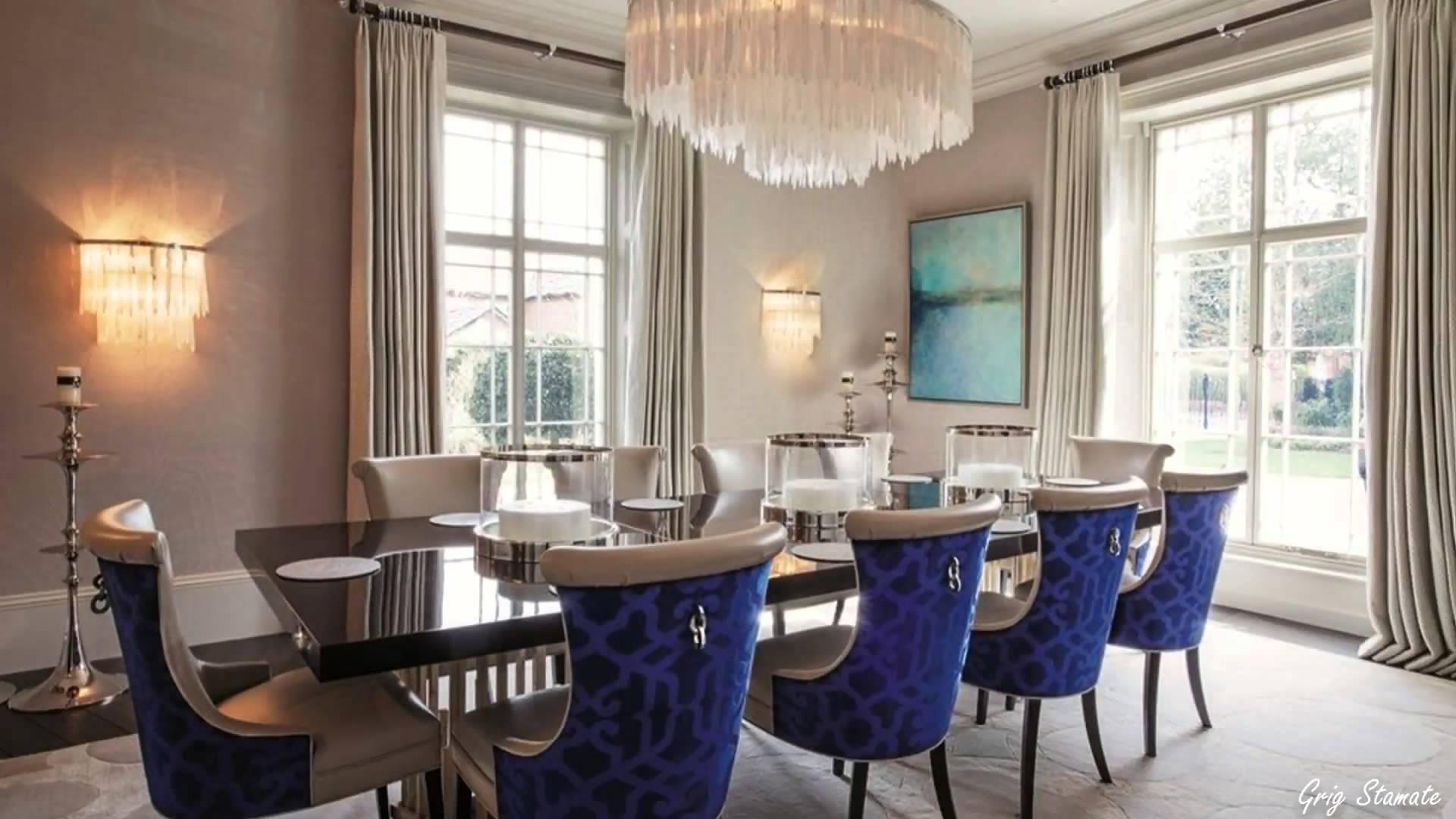 Luxury dining room with tasselled chandelier and blue geometric chairs