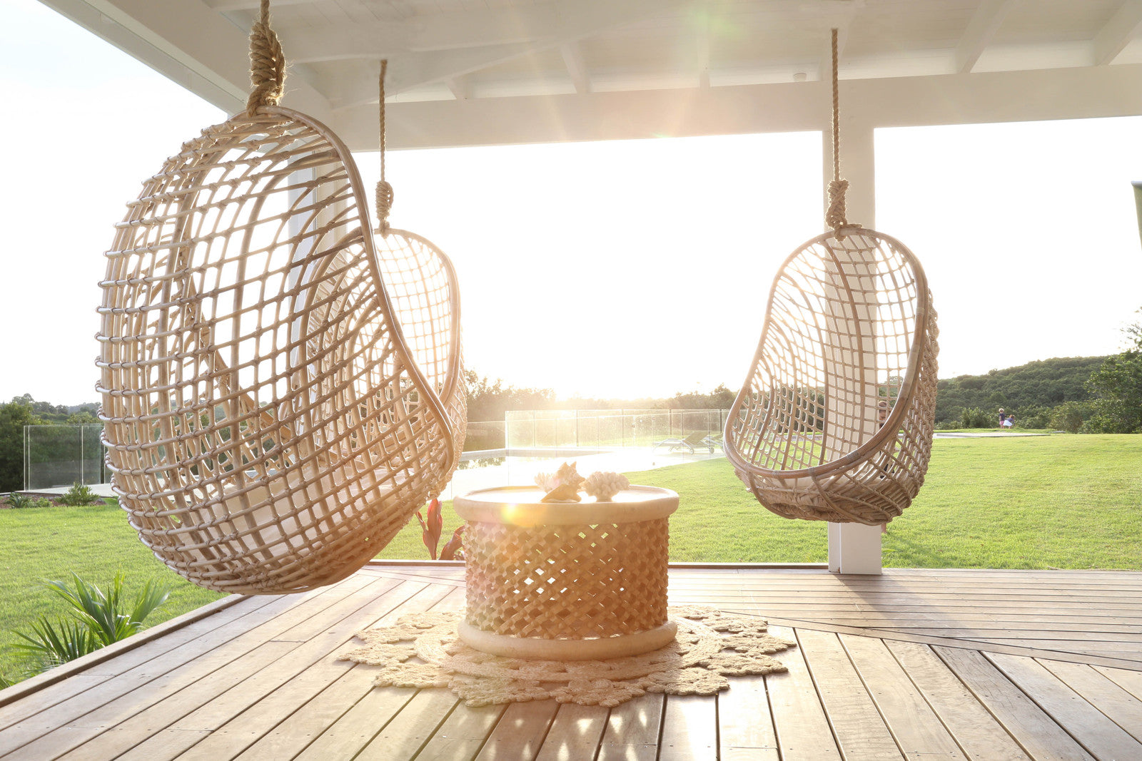 Wooden wicker chairs hanging on a large wooden porch