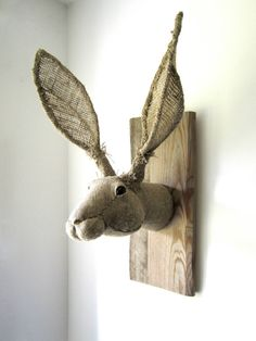 Humorous fabric hare head mounted on the wall like a trophy