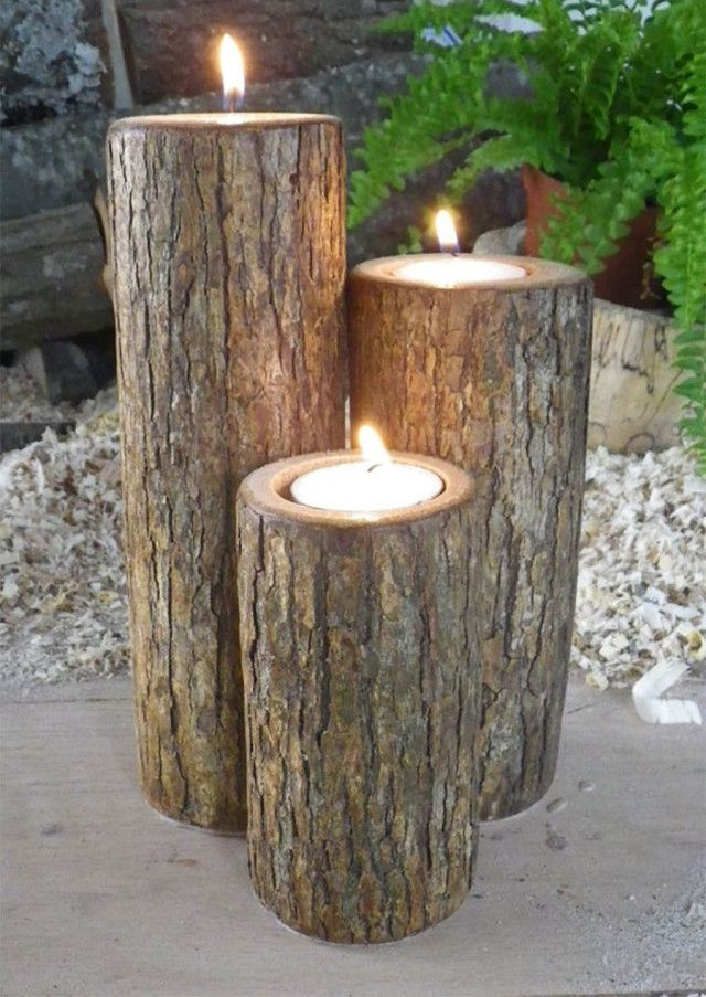 Three logs used as outdoor candle holders
