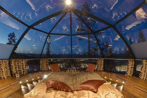 A full ceiling dome skylight exposing the beauty of the night sky, with padded floor cushions