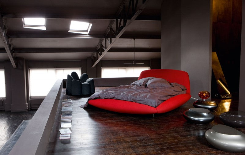 Industrial modern mezzanine sleeping area with red bed and grey covers