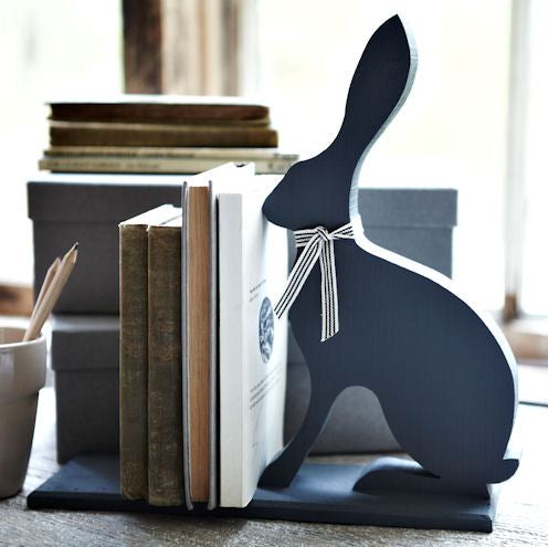 Black wooden bookend in the style of a hare with a scarf