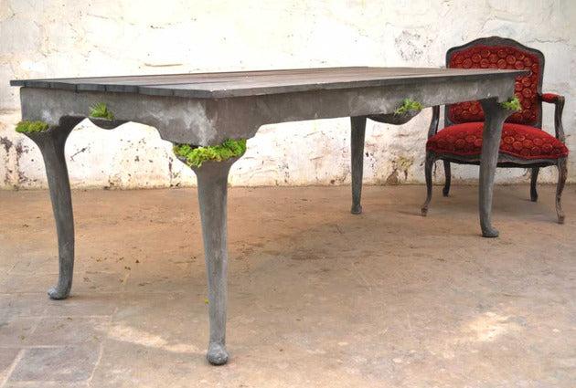 Queen Anne Table Made From Concrete With Plant Pockets On Each Corner