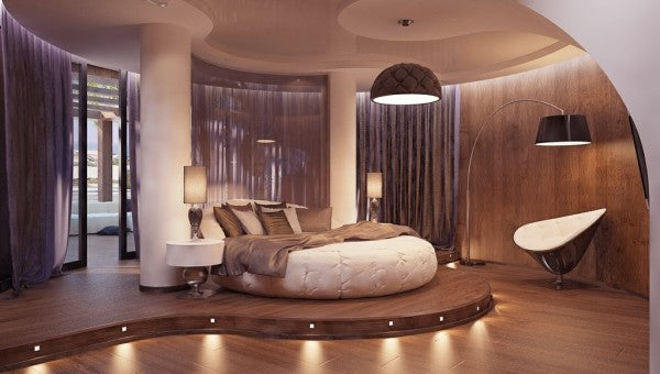 Funky beige and soft purple bedroom with white round bed and mood lighting