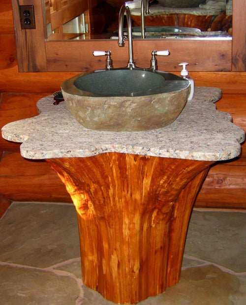 Orange wood stained log with marble top and marble sink basin