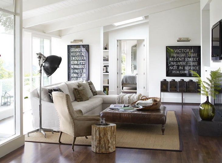 White living room with cream sofa, beige armchair and brown leather coffee table