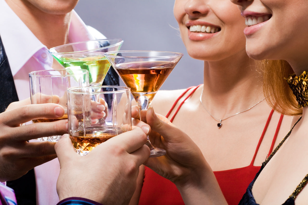 Celebration with four people clinking glasses