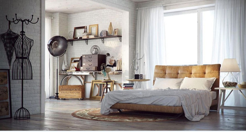 Urban bedroom design with tan leather sleigh bed