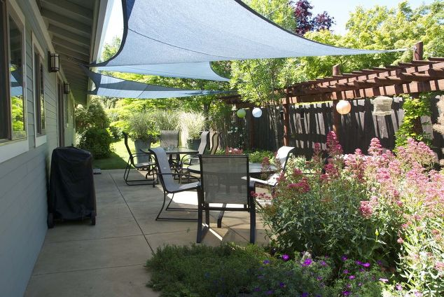 adding-shade-outdoors-with-triangular-nylon-shade-sails-outdoor-living-patio-repurposing-upcycling